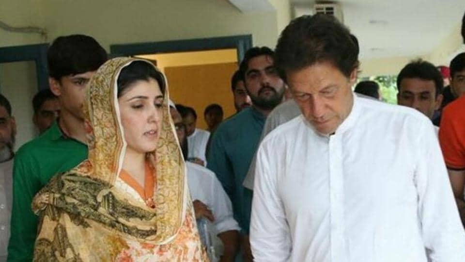 Pakistan Tehreek-e-Insaf chief Imran Khan seen with Ayesha Gulalai (left), a lawmaker from Pakistan's tribal areas who has quit the party after accusing Khan of harassing its women leaders.