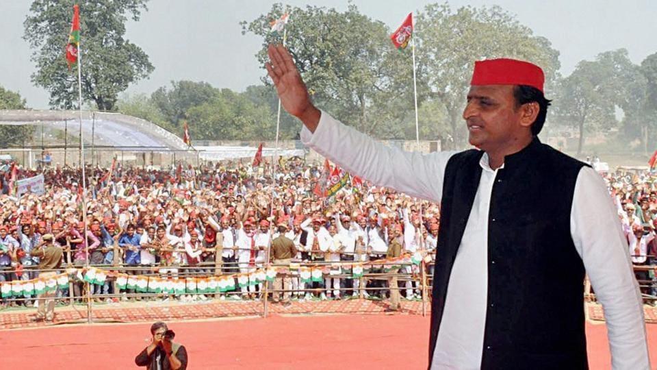 Former Uttar Pradesh CM Akhilesh Yadav waves at people during an election rally in Ballia district.