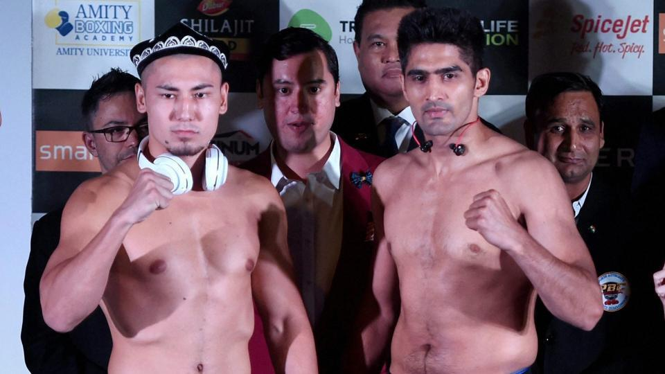 Vijender Singh and Zulpilkar Maimaitiali during their weigh-in and face-off for 'Battleground Asia'.