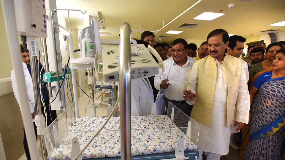Union tourism minister Mahesh Sharma inspects the new facilities at the children's hospital.