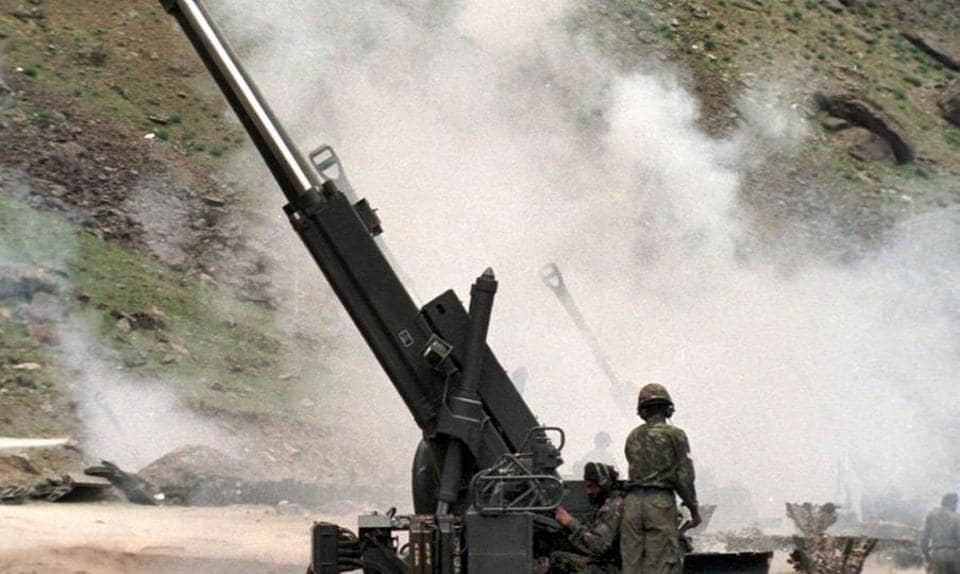 File photo of Indian artillery men firing 155mm Bofors guns at enemy positions on the Srinagar to Kargil road, June 1999.  At the end of Operation Vijay, the shoulders of the Indian nation-state were drooping with the burden of 537 martyrs. Even during this war the shortfall of essential ammunition had been revealed.