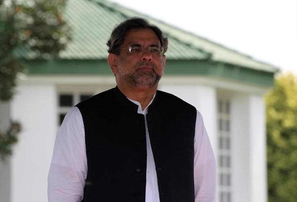 Pakistan's Prime Minister Shahid Khaqan Abbasi reviews the guard of honour in Islamabad on August 3, 2017.