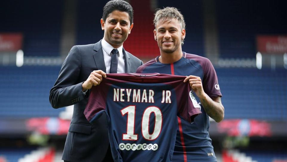 New Paris Saint-Germain signing Neymar Jr (R) and chairman Nasser Al-Khelaifi pose with the club shirt.