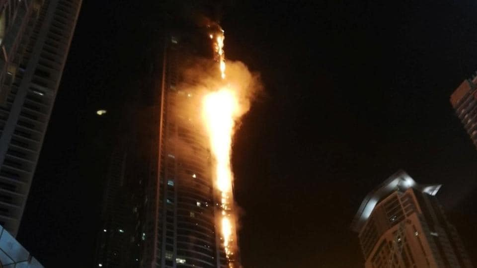 Flames shoot up the sides of the Torch tower residential building in the Marina district, Dubai, United Arab Emirates, in this August 4, 2017 picture by Mitch Williams.