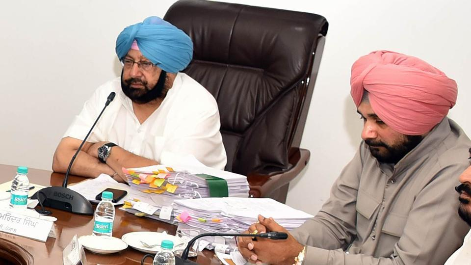 Punjab chief minister Captain Amarinder Singh presiding over the Cabinet meeting with Navjot Sidhu sitting next to him.