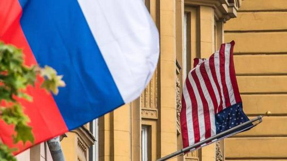A Russian flag flies next to the US embassy building in Moscow.