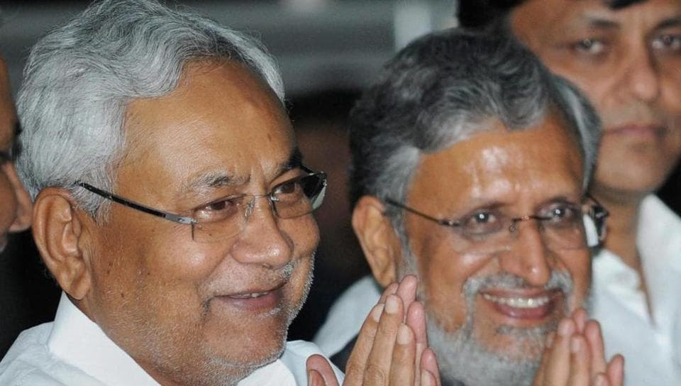 Bihar chief minister Nitish Kumar with deputy chief minister Sushil Kumar Modi in Patna, on July 29, 2017.  As many as 22 of the 29 ministers (76%) in the newly-formed Nitish Kumar cabinet face criminal charges.