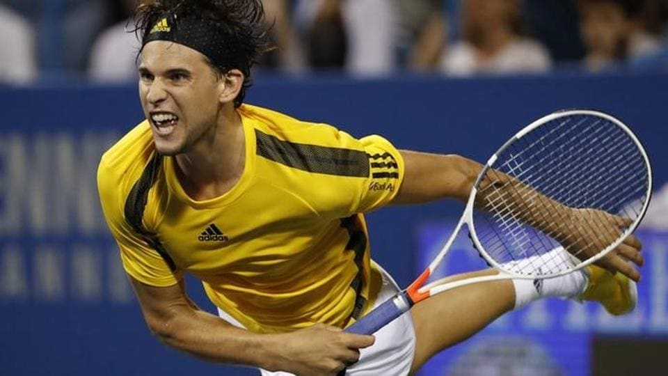 Dominic Thiem of Austria serves against Kevin Anderson of South Africa (not pictured) on day four of the Citi Open.