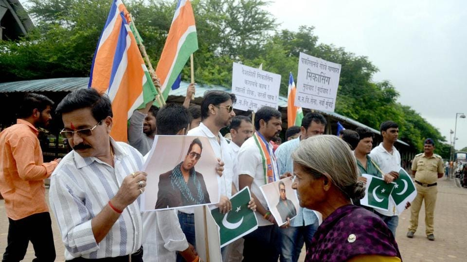 MNS party workers stage protests against singer Mika Singh at the Kopar Khairane railway station.