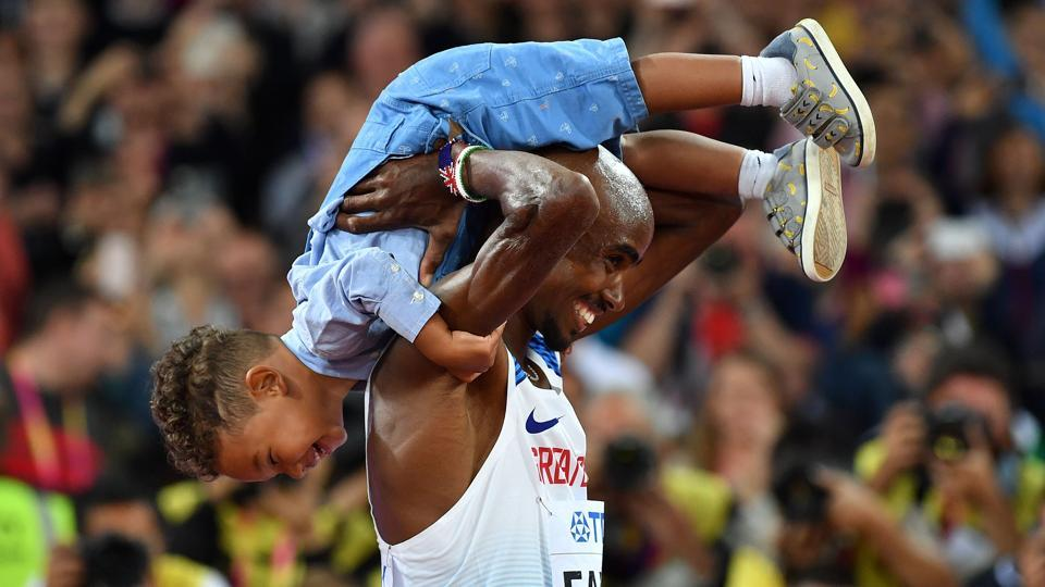 Britain's Mo Farah celebrates with his son after winning the final of the men's 10,000m race at the 2017 IAAF World Championships in London on Friday.