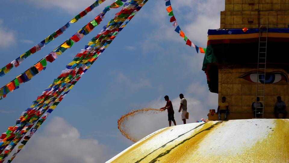 A man splashes paint on the dome of Boudhanath Stupa, a UNESCO world heritage site famous among tourists, in Kathmandu, Nepal. (Navesh Chitrakar  / REUTERS)