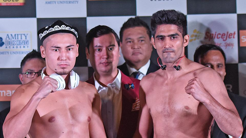 Indian boxing and WBO Asia-Pacific Super Middleweight champion Vijender Singh and WBO Oriental Super Middleweight champion China's Zulpikar Maimaitiali pose for the media during the official weigh-in and face-off at NSCI in Mumbai on Friday. Live streaming of Vijender Singh vs Zulpikar Maimaitiali will be available online