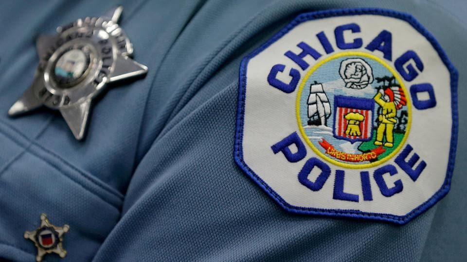 A Chicago police officer attends a news conference announcing the department's plan to hire nearly 1,000 new police officers in Chicago, Illinois, US.