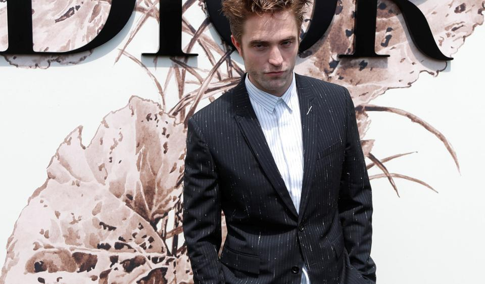 Robert Pattinson poses before Dior fashion house Haute Couture Fall/Winter 2017/2018 show in Paris.