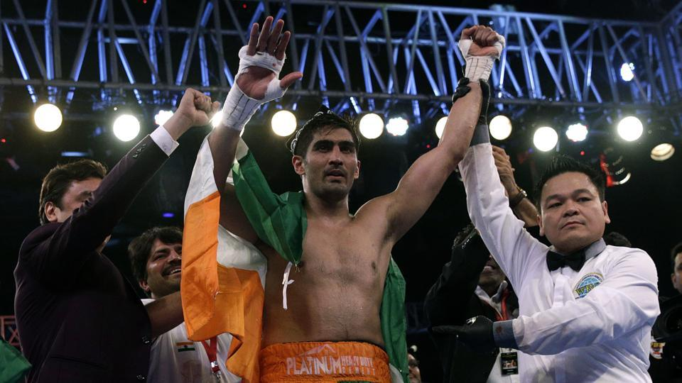 Indian boxing and WBO Asia-Pacific Super Middleweight champion Vijender Singh celebrates after winning the double title against WBO Oriental Super Middleweight champion of China Zulpikar Maimaitiali in Mumbaion Saturday.