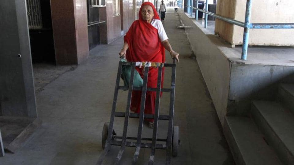 Hariben Matiya, an Indian woman who has been working for decades as a porter -- traditionally a man's job in India, pushes a trolley at the Bhavnagar railway station in Gujarat state.