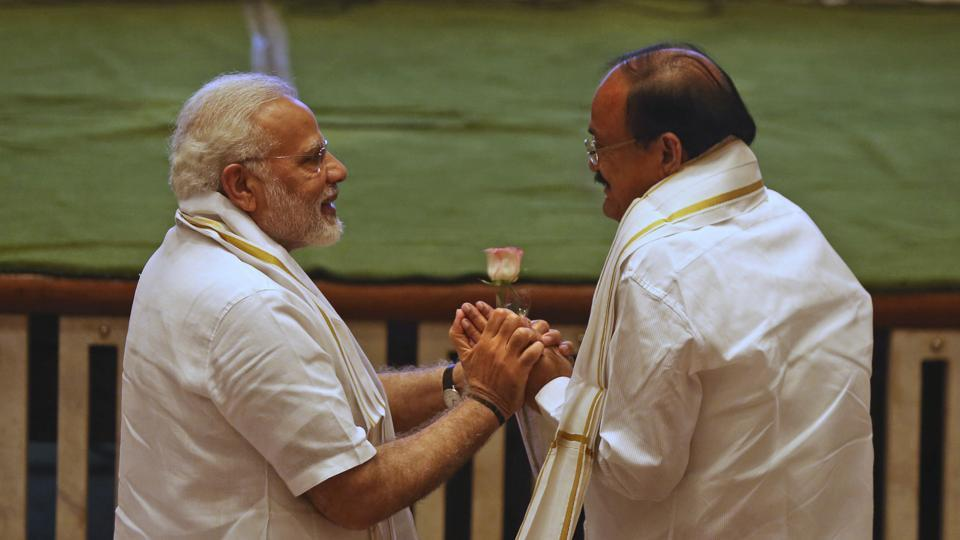 Prime Minister Narendra Modi with BJP's vice president candidate Venkaiah Naidu at a function in New Delhi, on August  4, 2017. The election to decide India's 15th Vice President will be held on August 5.