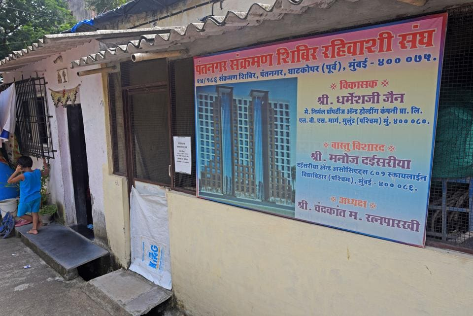 A redevelopment project board at Pant Nagar transit camp in Ghatkopar on Friday.