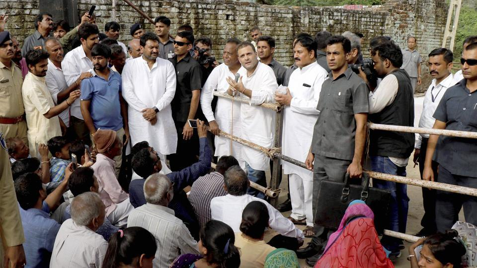 Congress vice president Rahul Gandhi interacts with the flood-affected people during his visit to Banaskantha district of Gujarat on Friday.