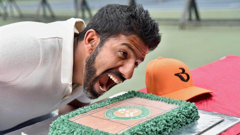 French Open mixed doubles winner Rohan Bopanna poses with a cake at a felicitation ceremony at the Karnataka State Lawn Tennis Association (KSLTA) in Bengaluru. Bopanna is angry for not being nominated for the Arjuna Award.