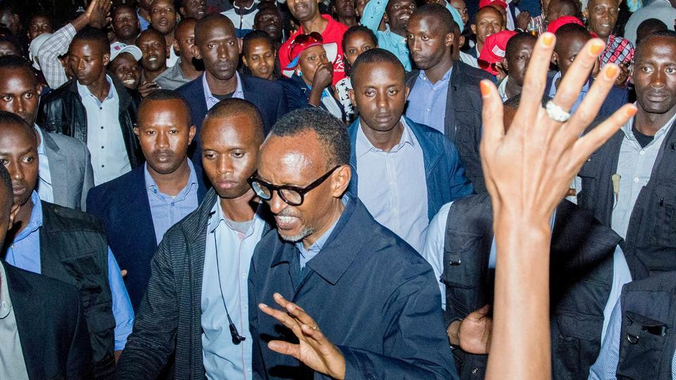 Rwandan President Paul Kagame (centre) celebrates his re-election with supporters in Kigali on Saturday at the Rwandan Patriotic Front headquarters.