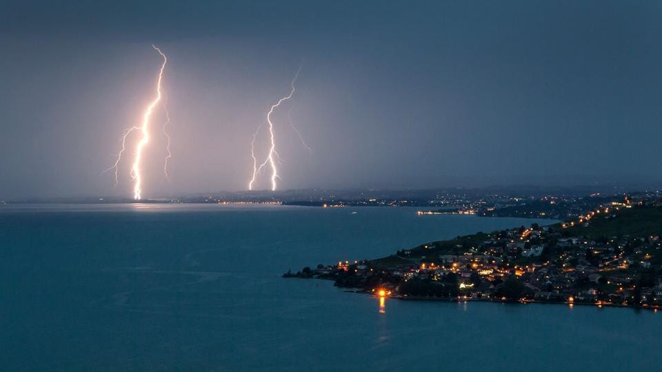 Lightning illuminates the night sky over the village of Cully surrounded by the vineyard terraces of Lavaux on the bank of Leman Lake from Chexbre. (Fabrice COFFRINI / AFP)