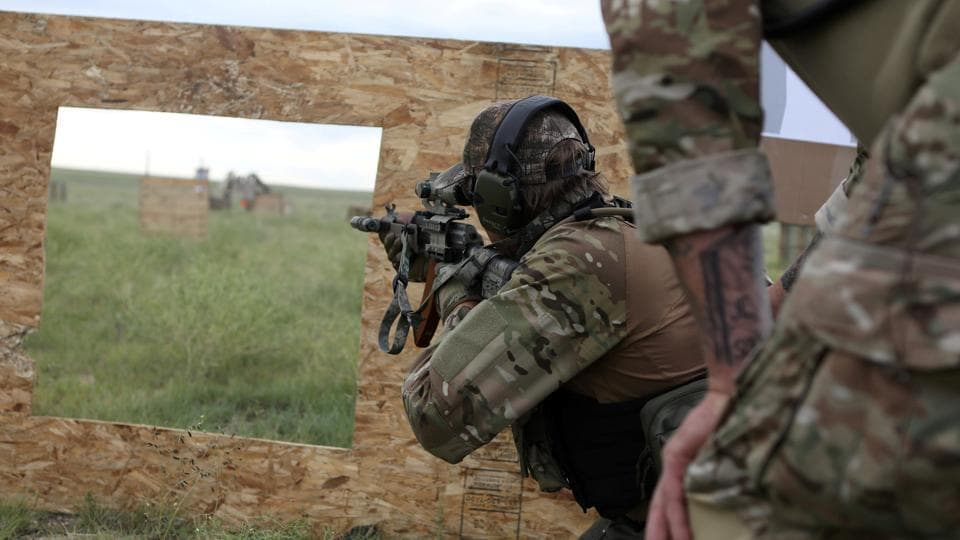 Members of self-described patriot groups and militias run through shooting drills during III% United Patriots Field Training Exercise, which they describe as the largest patriot event in the country, outside Fountain, Colorado, U.S. (REUTERS)