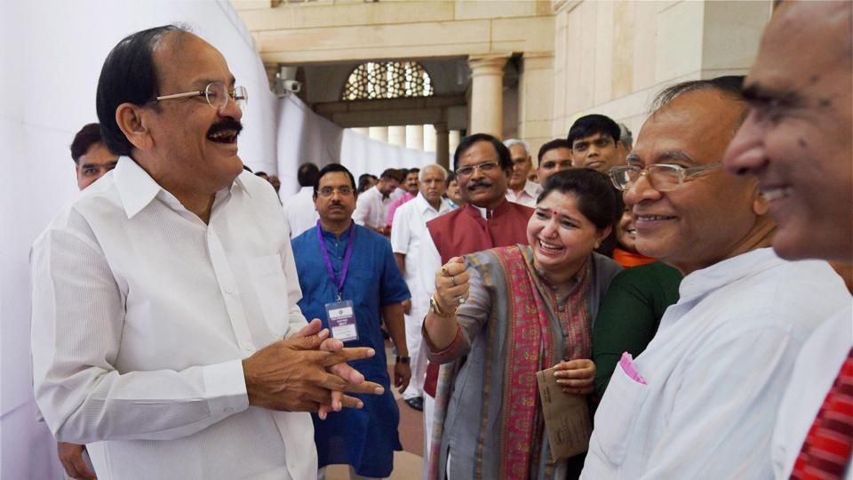 Venkaiah Naidu sharing a light moment with other MPs as he arrives to cast his vote in the vice presidential election on Saturday.