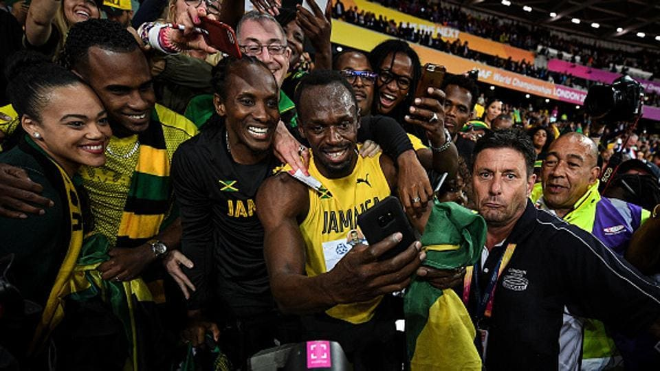 Usain Bolt takes time out to capture the moment with his family and supporters during the lap of honour after his the final of the 100m race at the IAAF World Championships of Athletics in London on Saturday. Bolt finished the last 100m race of his career in third place, with American Justin Gatlin winning it ahead of Christian Coleman.