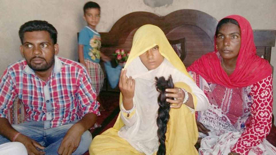 Meena Devi of Chandu village in Sangrur showing the braid that she claimed was chopped in sleep on Friday night.