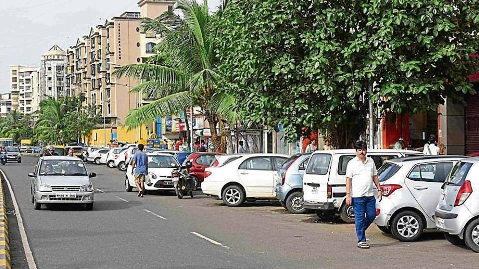 Vehicles are parked on a road at Sanpada, leaving little space for motorists.