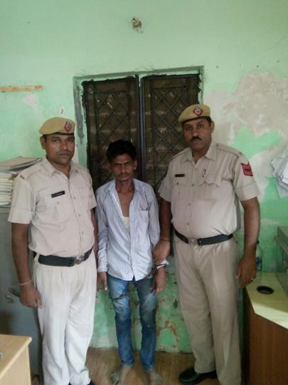 The accused Mahesh alias Sugrat Yadav affer being arrested.