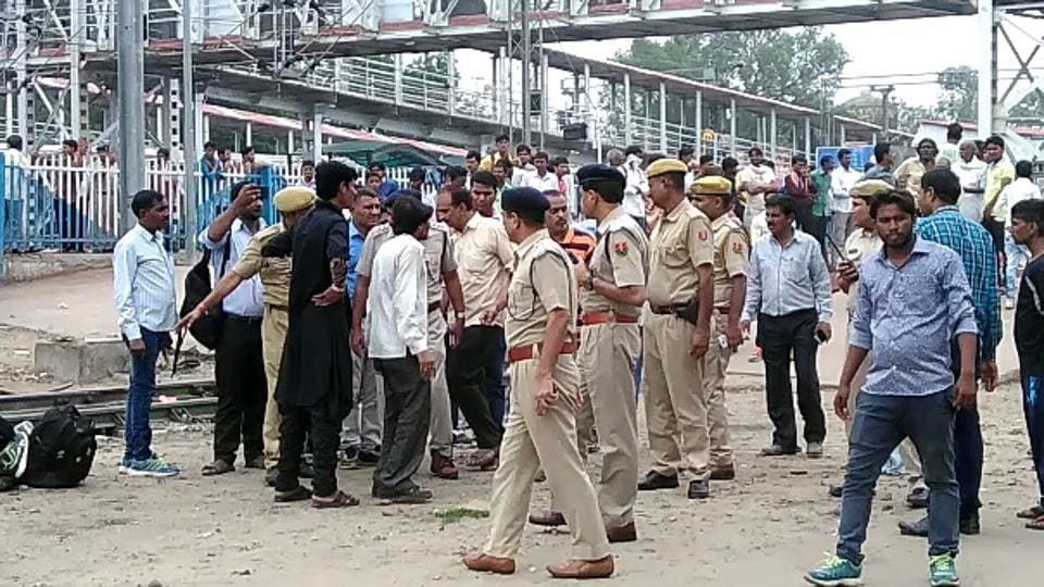 Police at the Sawimadhopur station after the accident on Sunday.