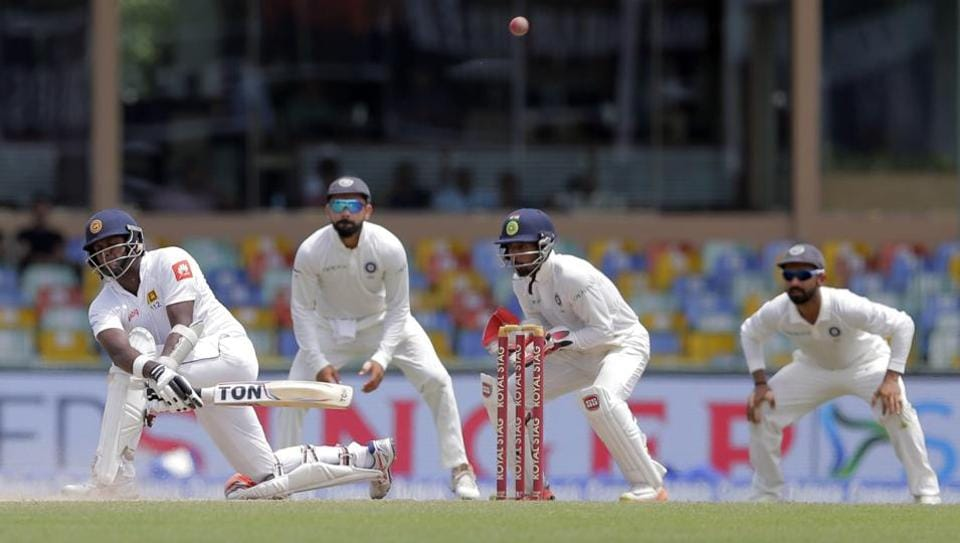 Sri Lanka's Angelo Mathews plays a sweep shot during the 2nd Test against India.