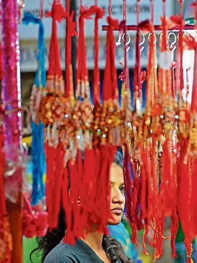 A woman does some last-minute rakhi shopping at a roadside stall in Parel on Sunday.
