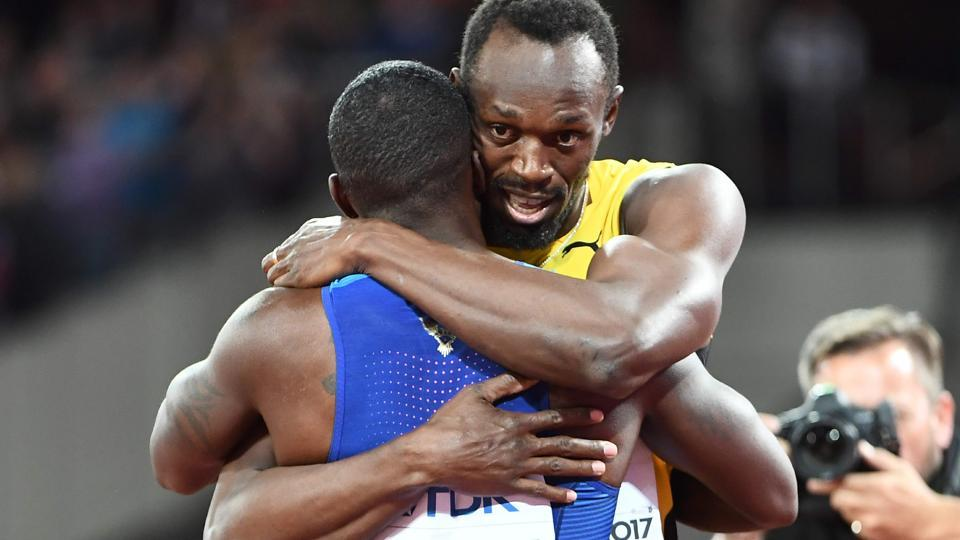 Usain Bolt (R) hugs Justin Gatlin after the final of the men's 100m at the IAAF World Championships of Athletics in London on Saturday.