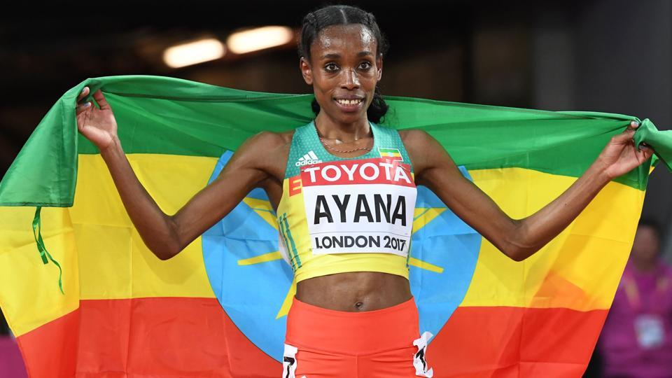 Ethiopia's Almaz Ayana celebrates after winning the final of the women's 10,000m athletics event.