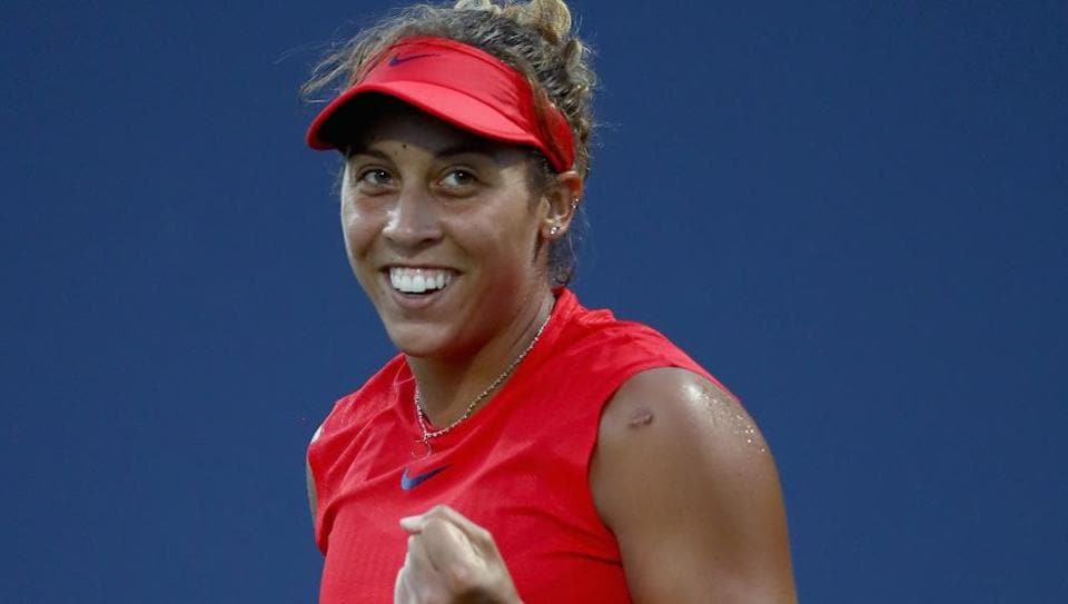 Madison Keys of the United States reacts after beating Garbine Muguruza of Spain in their Stanford Classic semifinal match.