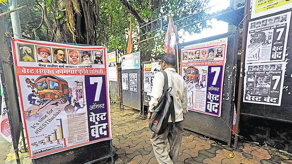 A man wallks past posters featuring HT's #BESTBachao campaign, outside Wadala bus depot in Mumbai on Saturday.