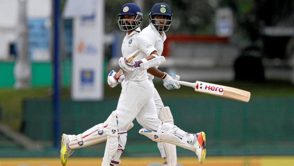 India's Ajinkya Rahane and Ravichandran Ashwin run between wickets. (Dinuka Liyanawatte  / REUTERS)