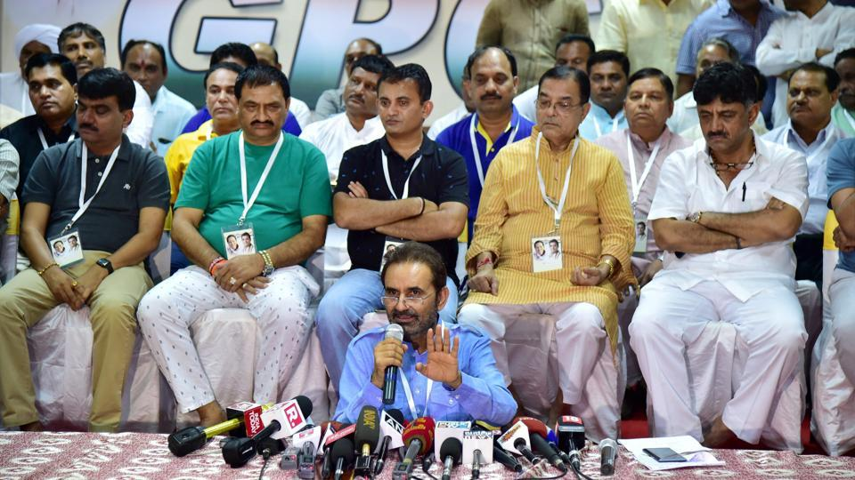 Congress spokesperson Shakti Singh Gohil speaks as Gujarat Congress MLAs seen behind him during a press conference at a resort on the outskirts of Bengaluru on Sunday.