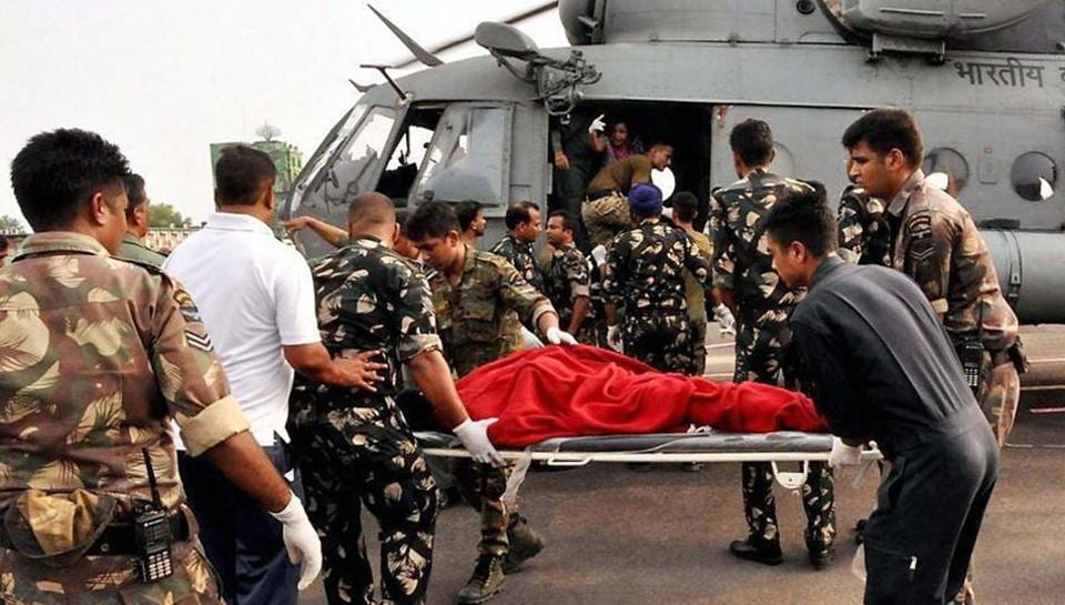 Injured pilgrims and passengers being taken to hospital by the rescue team of IAF at Air Force Station Jammu on July 16, 2017. At least 16 Amarnath pilgrims were killed and around 30 others injured when their bus skidded off the Jammu-Srinagar national highway and rolled down into a deep valley.