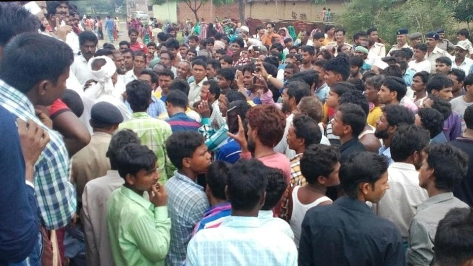 Mob at Nawadih village, outside the Eidgah, following recovery of meat, in Deoghar, on Sunday morning,  August 6, 2017.