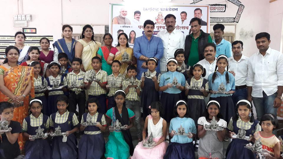 Students pose with ecofriendly Ganesh idols they made during the workshop organised at Pandit Deendayal Upadhyay School in Kothrud.