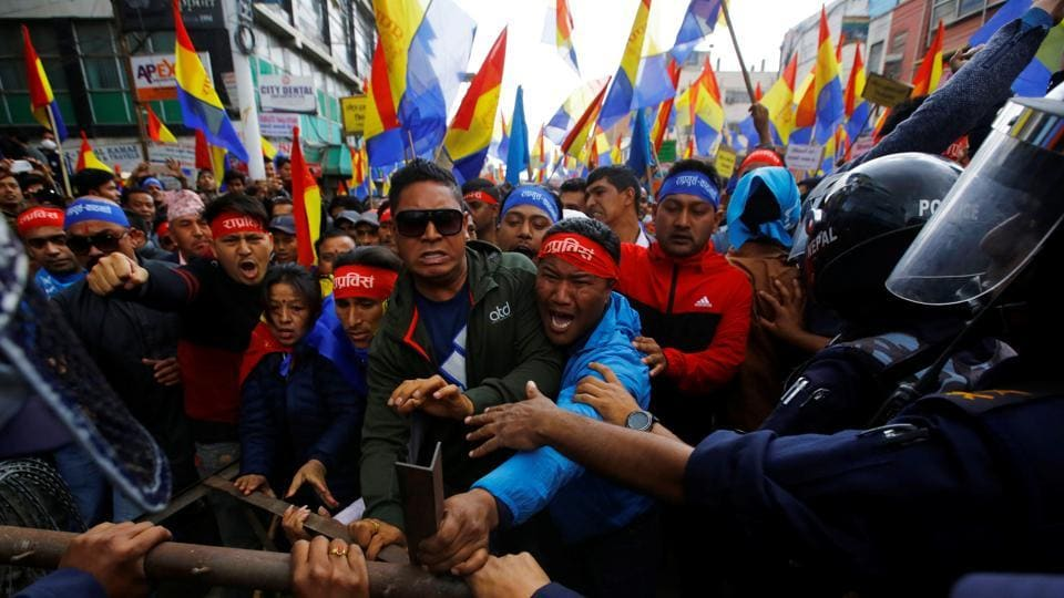 Hindu activists affiliated with Rastriya Prajatantra Party Nepal try to break through the barricade as they march towards the Election Commission during their protest after the election commission rejected their campaigning for monarchy and Hinduism in Kathmandu on March 20.