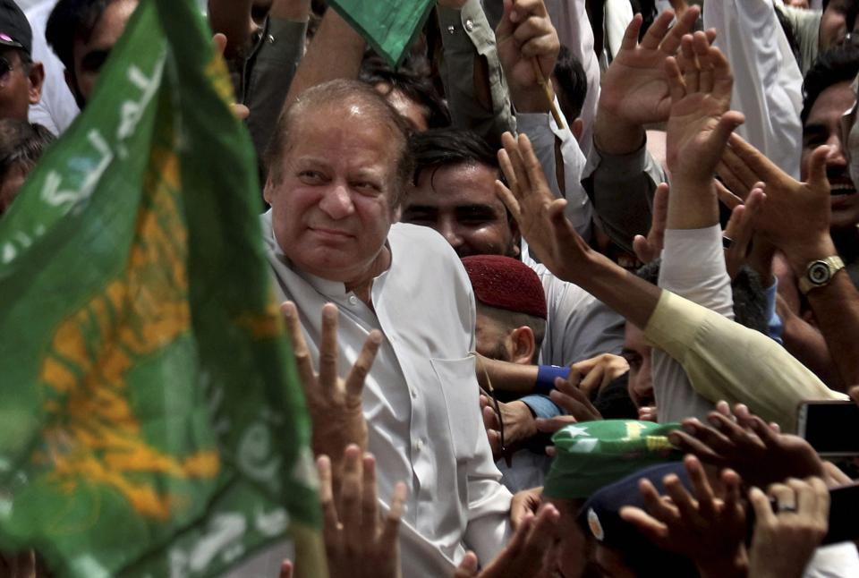 Nawaz Sharif is welcomed by supporters at Bhara Kahu area, on the outskirts of Islamabad.