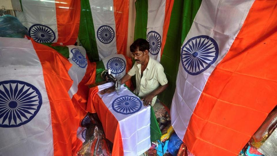 A tailor stiches Indian national tricolour flag, ahead of the Independence Day, in Agartala on Thursday. (PTI)