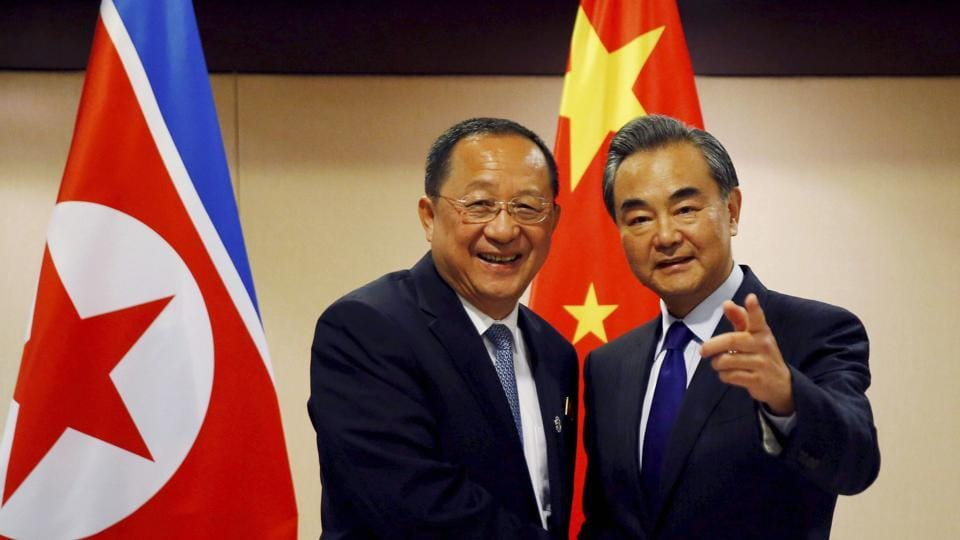 North Korean foreign minister Ri Yong Ho, left, is greeted by his Chinese counterpart, Wang Yi, prior to their bilateral meeting on the sidelines of the 50th ASEAN foreign ministers' meet on August 6, 2017 in the suburban Pasay city of south Manila, Philippines.