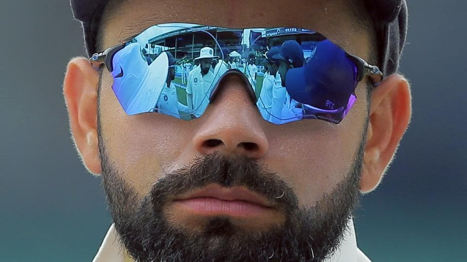 Indian players are reflected in the goggles of team captain Virat Kohli before the start of the fourth day's play of their second cricket test match against Sri Lanka in Colombo, Sri Lanka. (Eranga Jayawardena / AP)