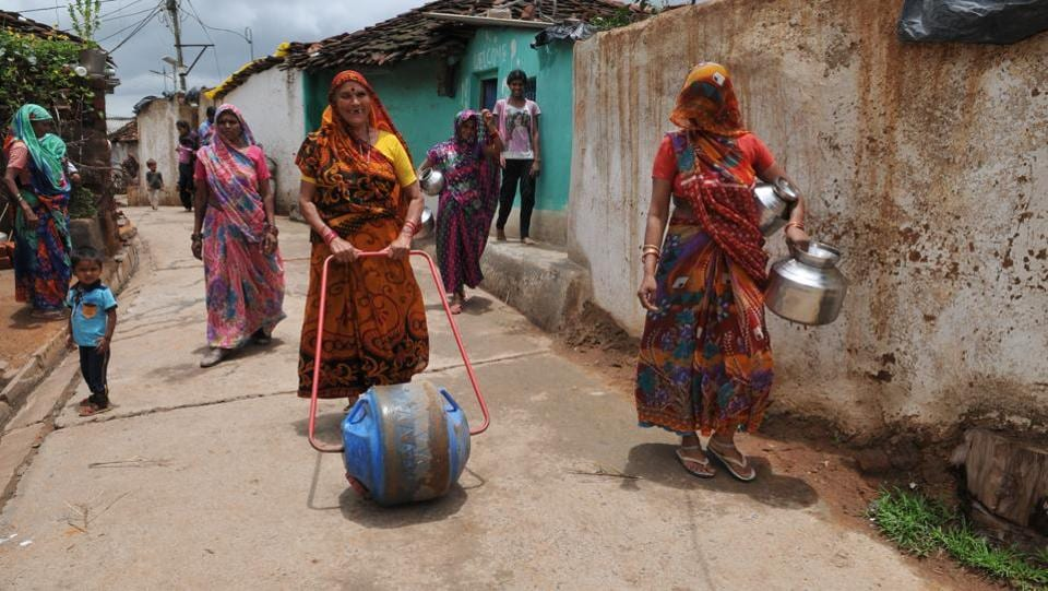 Villagers taking water to their homes in water wheel drums in village Patharihaveli in Vidisha District, India. (Mujeeb Faruqui/HT Photo)